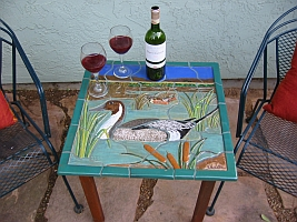 Pintail duck table setting with wine