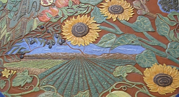 Dining room table detail -- fields of sunflowers and row crops